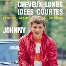 Johnny Hallyday cheveux long et idees courtes . (clip vidéo) .